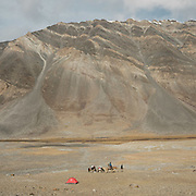 """Paul Salopek's tent. Camp at a Wakhi high pasture names """"Warm"""", below Garumdee Pass. Guiding and photographing Paul Salopek while trekking with 2 donkeys across the """"Roof of the World"""", through the Afghan Pamir and Hindukush mountains, into Pakistan and the Karakoram mountains of the Greater Western Himalaya."""