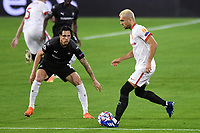 SEVILLE, SPAIN - OCTOBER 28: Joan Jordan of FC Sevilla and Jonas Martin of Stade Rennais during the UEFA Champions League Group E stage match between FC Sevilla and Stade Rennais at Estadio Ramon Sanchez-Pizjuan on October 28, 2020 in Seville, Spain. (Photo by Juan Jose Ubeda/ MB Media).