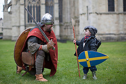 © licensed to London News Pictures. York, UK 23/02/2013. A re-enactment performer meeting an enthusiastic child before his 'battle' next to Clifford's Tower in York. Over 200 re-enactment performers meeting at Jorvik Viking Festival 2013 in York to fight a re-enactment battle as Vikings and Anglo-Saxon knights. Photo credit: Tolga Akmen/LNP
