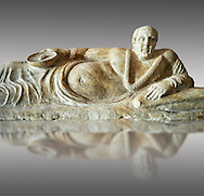 Close up of an Etruscan Hellenistic style cinerary, funreary, urn cover with a man,  National Archaeological Museum Florence, Italy , against grey .<br /> <br /> If you prefer to buy from our ALAMY PHOTO LIBRARY  Collection visit : https://www.alamy.com/portfolio/paul-williams-funkystock - Scroll down and type - Etruscan Florence - into LOWER search box. (TIP - Refine search by adding a background colour as well).<br /> <br /> Visit our ETRUSCAN PHOTO COLLECTIONS for more photos to download or buy as wall art prints https://funkystock.photoshelter.com/gallery-collection/Pictures-Images-of-Etruscan-Historic-Sites-Art-Artefacts-Antiquities/C0000GgxRXWVMLyc