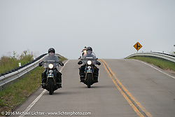 Father and son ride together - Ken McManus riding his 1936 Harley-Davidson Knucklehead (r) beside his son Matt McManus on an exactly identical machine as they lead a group of Cannonballers through some dismal weather during Stage 7 of the Motorcycle Cannonball Cross-Country Endurance Run, which on this day ran from Sedalia, MO to Junction City, KS., USA. Thursday, September 11, 2014.  Photography ©2014 Michael Lichter.