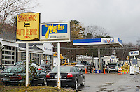 Sanborn's Auto Repair in the process of removing their gas tanks on Monday morning.  (Karen Bobotas/for the Laconia Daily Sun)