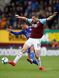 Leicester City's Youri Tielemans (left) and Burnley's Chris Wood (right) battle for the ball during the Premier League match at Turf Moor, Burnley.