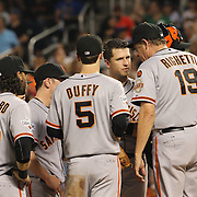Buster Posey, (facing), San Francisco Giants, on the pitching mound with the team during the New York Mets Vs San Francisco Giants MLB regular season baseball game at Citi Field, Queens, New York. USA. 11th June 2015. Photo Tim Clayton