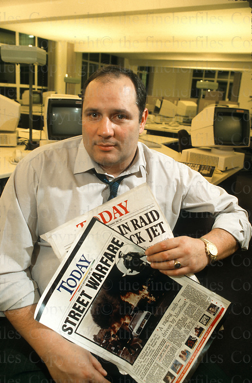 Eddy Shah owner of British newspaper 'Today' seen in his Vauxhall, London,UK office in 1986. Photo by Terry Fincher.