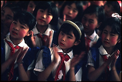 School children sing at an elementary school in a rural area outside of Beijing, China.
