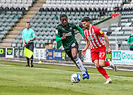Sunderland Forward Jordan Jones (27) on the ball and attacking while under pressure from Plymouth Argyle midfielder Tyrese Fornah (18)  during the EFL Sky Bet League 1 match between Plymouth Argyle and Sunderland at Home Park, Plymouth, England on 1 May 2021.