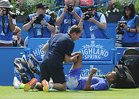 Tennis - 2017 Aegon Championships [Queen's Club Championship] - Day One, Monday<br /> <br /> Men's Singles, Round of 32<br /> Nick Kyrgios [Aus] vs. Donald Young [USA]<br /> <br /> Nick Kyrgios receives attention after falling over on Centre Court.<br /> <br /> COLORSPORT/ANDREW COWIE