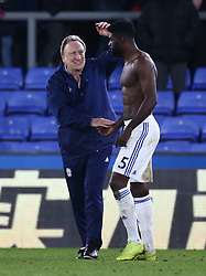 Cardiff City manager Neil Warnock and player Bruno Ecuele Manga after the Premier League match at Selhurst Park, south east London.