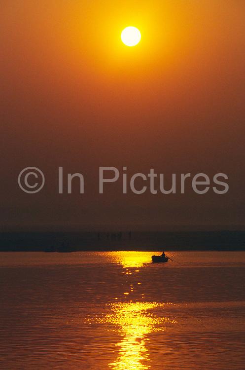 Sunrise over the River Ganges at Varanasi, India