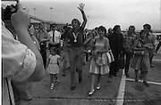 1983-15-08.15th August 1983.15-08-1983.08-15-83..Photographed at Dublin Airport..Pressed:..Gold medalist Eamonn Coughlan geeeted by press and supporters on the tarmac of Dublin Airport on his return from the World Athletic Championships in Finland. His wife Yvonne and chldren Suzanne (four) and Eamonn Jn (two) are with him. Suzanne iwalks hand in hand with her dad while his wife holds Eamonn Jn.