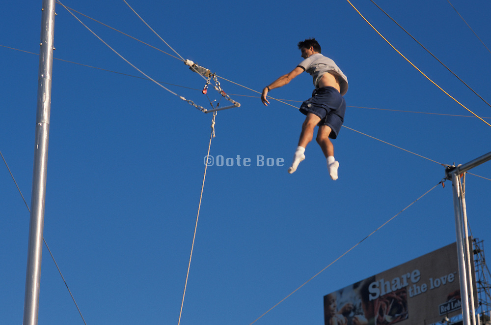 Trapeze acrobat practicing for his act