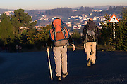 Liana and Parmenter Welty hike the Camino de Santiago pilgrimage on a road as they are at their final destination - Santiago de Compostela, in Galicia, Spain.