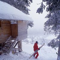 David Quammen by cabin in Carpathian Mountains near Zarnesti.