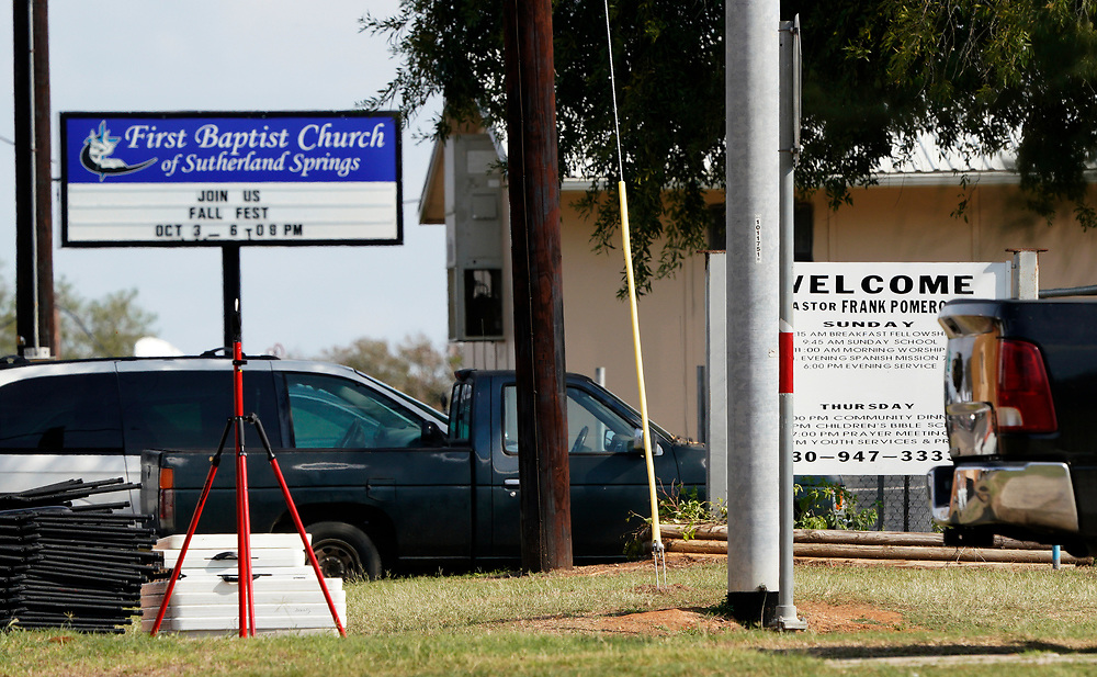 Signs near the entrance of the First Baptist Church, the site of the shooting in Sutherland Springs, Texas, U.S. November 7, 2017.  REUTERS/Rick Wilking