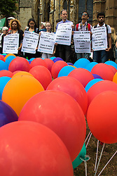 Old Palace Yard, Westminster, July 25th 2015. Protesters gather outside the Houses of Parliament to demand electoral reform, including proportional representation rather than the first-past-the-post method that saw the Tories gain a majority. PICTURED: Balloons representing the different political parties stand within a map of Britain.