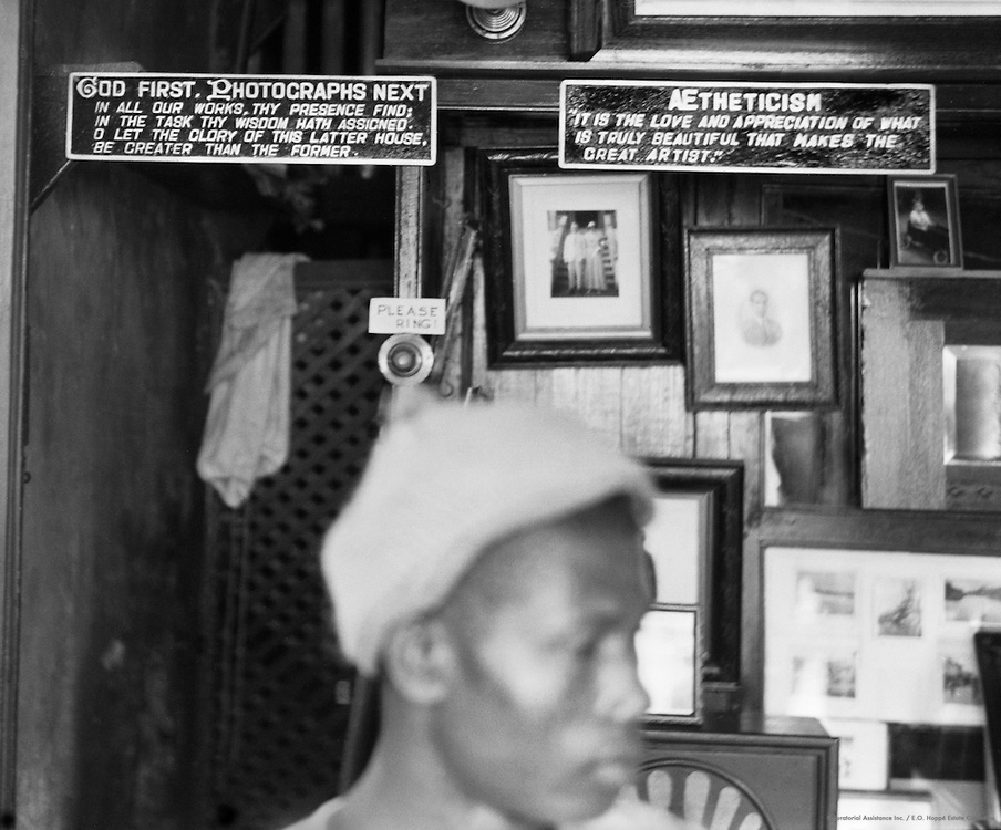 Man in Front of Photo Shop Wall, Freetown, Sierra Leone, Africa, 1937