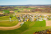 Aerial photograph of Hollandale, Wisconsin and rural Wisconsin, with Blue Mound State Park on the horizon.