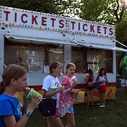 Young girls enjoy cotton candy during the May Fair at Saint Mark's Church, New Canaan, Connecticut, USA. 12th May 2012. Photo Tim Clayton