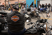 A leather clad biker sits on his Harley Davidson motorcycle watching the parade of riders during the 74th Annual Daytona Bike Week March 7, 2015 in Daytona Beach, Florida.
