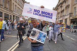 © Licensed to London News Pictures. 25/09/2021. Newcastle, UK. Anti-vaxxers hold banners and shout slogans as they march through the streets of Newcastle  against mandatory vaccination passports and the vaccination of teenagers.  Photo credit: Ioannis Alexopoulos/LNP
