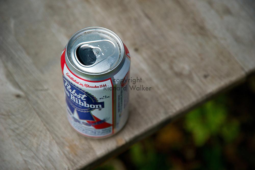 2010 November 21 - Pabst Blue Ribbon beer can as ashtray on table. Seattle, WA, USA. CREDIT: Richard Walker