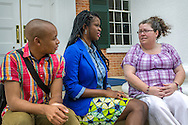 University of Mississippi students Nathaniel Weathersby and Renee Ombaba sit on the steps of the Lyceum and talk with Susan Glisson, executive director of the William Winter Institute for Racial Reconciliation, July 30, 2013, in Oxford, Miss. Ombaba and Glisson organized a candlelight unity walk last fall after a racially-charged skirmish broke out on campus following the re-election of President Barack Obama. Weathersby is president of the UM Pride Network, which works to make campus a safer, more positive environment for gay and lesbian students, and Ombaba helped spearhead the Collegiate Council for Civil Rights Commemoration, which uses historical events of the civil rights movement as teachable moments to improve race relations on campus. The Lyceum was the site of violence in October 1962, when riots broke out after James Meredith enrolled as the first black student on campus. (Photo by Carmen K. Sisson/Cloudybright)
