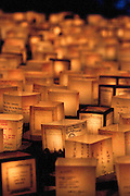 Hundreds of lanterns floating in the ocean in memory of those that have passed.