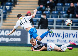 Falkirk's Stephen Kingsley slides into Morton's Tomas Peciar.<br /> Falkirk 1 v 1 Morton, Scottish Championship game today at The Falkirk Stadium.<br /> © Michael Schofield.