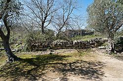 Rovine del Palazzo del barone Salzedo, sec. XVIII. Si tratta della residenza rurale dei Baroni Salzedo, edificata nella località di Stigliano nel 1768, l'organismo architettonico conserva solo un elegante portale d'ingresso con stemma della famiglia. Versa in uno stato di conservazione pessimo, non è fruibile, merita il recupero. A pochi metri si erge la Chiesa di Santa Marina di Stigliano. Le costruzioni si trovano a circa 3 chilometri da Serrano, in aperta campagna, sui resti dell'antico feudo di Stigliano. La piccola chiesetta dedicata a Santa Marina fu costruita nel 1762 per volontà del barone Domenico Salzedo insieme all'adiacente complesso architettonico. La chiesa, a croce greca, presenta tre altari. Quello maggiore conserva nella nicchia tonda l'immagine bizantina della titolare. Al di sotto della costruzione del Salzedo è situata una cripta rupestre con una serie di affreschi, alcuni dei quali difficilmente recuperabili, oggi ormai completamente invasa dai rovi. La tradizione orale narra che Stigliano era un paese sorto nel periodo bizantino. Quando sia stato distrutto il casale eventualmente esistito non lo sappiamo, può anche darsi che il centro sia stato abbattuto durante una delle varie scorrerie saracene. Proprio per sfuggire ai continui pericoli gli stiglianesi avrebbero riparato sulla collina fondando Serrano. Verso la fine del XIV secolo, il feudo di Stigliano per un periodo abbastanza lungo appartenne ai Lubelli. Successivamente andò ai Tolomei i quali poi nel 1575 lo vendettero al barone Nicolò Personè di Carpignano; nel 1580 insieme con Castrignano dei Greci il feudo fu di Filippo Prato. Nel 1643 essendo i Prato in debito con la famiglia Marchese furono costretti a vendergli la loro proprietà. Stigliano con il casale di Castrignano passò in seguito ai Maresgallo, ai Prototico e ai Gualtieri. Da questi ultimi infine, intorno al 1749, il barone Salzedo di Otranto comprò il feudo ormai disabitato.