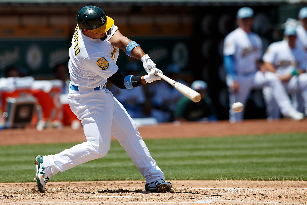 OAKLAND, CA - JUNE 17: Franklin Barreto #1 of the Oakland Athletics hits a single against the Los Angeles Angels of Anaheim during the third inning at the Oakland Coliseum on June 17, 2018 in Oakland, California. The Oakland Athletics defeated the Los Angeles Angels of Anaheim 6-5 in 11 innings. (Photo by Jason O. Watson/Getty Images) *** Local Caption *** Franklin Barreto