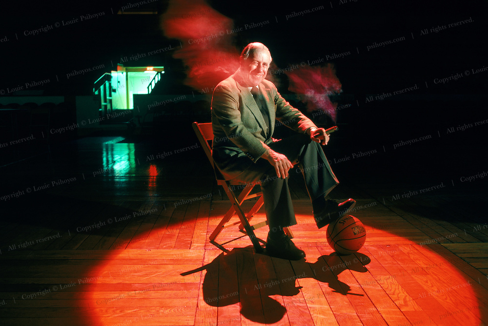 Red Auerback, legendary coach of the Boston Celtics dynasty, helped them win 12 of 14 NBA championships from 1957-69.   Photographed at the old Boston Garden.