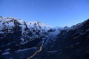 The Pasterze (glacier at Großglockner mountain) is the largest glacier in Austria and the eastern Alps measuring more than 8 km in length. Early in the morning, a mountaineer started hiking up onto Großglockner using a flashlight to find his way. High Tauern National Park, Austria. | Die Pasterze (Gletscher am Großglockner) ist mit etwas mehr als 8 km Länge der größte Gletscher Österreichs und der längste der Ostalpen. Früh morgens ist ein Bergsteiger gestartet, er will den Großglockner besteigen. Mit einer Lampe hat er sich den Weg über den Gletscher gesucht. Nationalpark Hohe Tauern, Österreich.