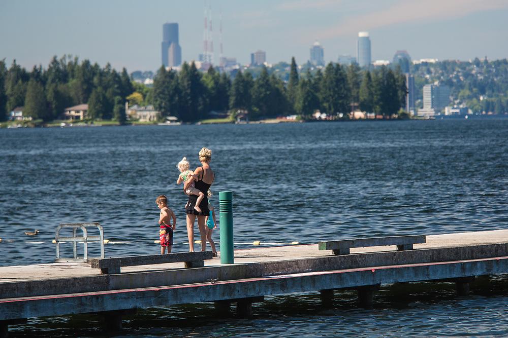 United States, Washington, Kirkland. Mother and children on pier on the  waterfront on Lake Washington
