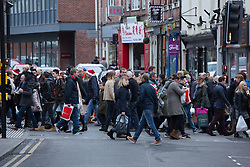 © Licensed to London News Pictures. 3/12/2016. Lincoln, UK. Thousands of people descended upon Lincoln over the weekend to start their Christmas shopping and visit the annual Christmas market. With over 200 stalls surrounding the Cathedral and Castle in the uphill area a one way system to control visitors had to be put in place due to the huge crowds thronging the City Centre. Picture shows shoppers walking up High Street and crossing the busy Silver Street. Photo credit: Dave Warren/LNP