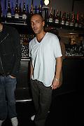 Calum Best, MILLA JOVOVICH, CARMEN HAWK & HARVEY NICHOLS CELEBRATE THE LAUNCH OF JOVOVICH-HAWK. FIFTH FLOOR CAFƒ. HARVEY NICHOLS. london.  27 April 2006. ONE TIME USE ONLY - DO NOT ARCHIVE  © Copyright Photograph by Dafydd Jones 66 Stockwell Park Rd. London SW9 0DA Tel 020 7733 0108 www.dafjones.com