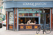 A couple having an evening meal at Lounge Brixton on the 23rd June 2018 in Brixton in the United Kingdom.