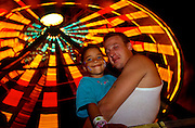 A young man and his daughter at a small town carnival in Bath Maine