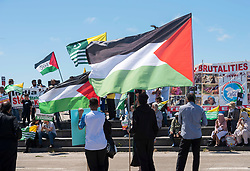 © Licensed to London News Pictures; 12/06/2021; Hayle, Cornwall UK. G7 summit in Cornwall. Supporters of Palestine hold the Palestinian flag at the Resist G7 coalition of protest groups protest in Hayle on the second day of the G7 summit. The protest included supporters of Palestine and of Kashmir as well as anti-war groups and socialists and trade unionists. Photo credit: Simon Chapman/LNP.