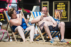 © Licensed to London News Pictures. 01/07/2015. Scarborough, UK. Families enjoy the sun on Scarborough beach. Britain is set to sizzle in temperatures of up to 34C (93F) today, with forecasters predicting the hottest day for several years. A tropical air mass moving from North Africa, Spain and Portugal means that we could be hotter than Rio de Janeiro. Photo credit : Andrew McCaren/LNP