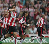 Photo: Lee Earle.<br /> Southampton v Plymouth Argyle. Coca Cola Championship. 16/09/2006. Southampton's Grzegorz Rasiak (L) celebrates after scoring their opening goal.