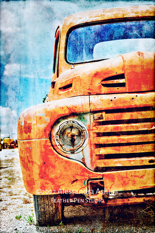 Vintage orange Ford truck with flat tire and missing headlight, High dynamic range image, composited with metallic texture.