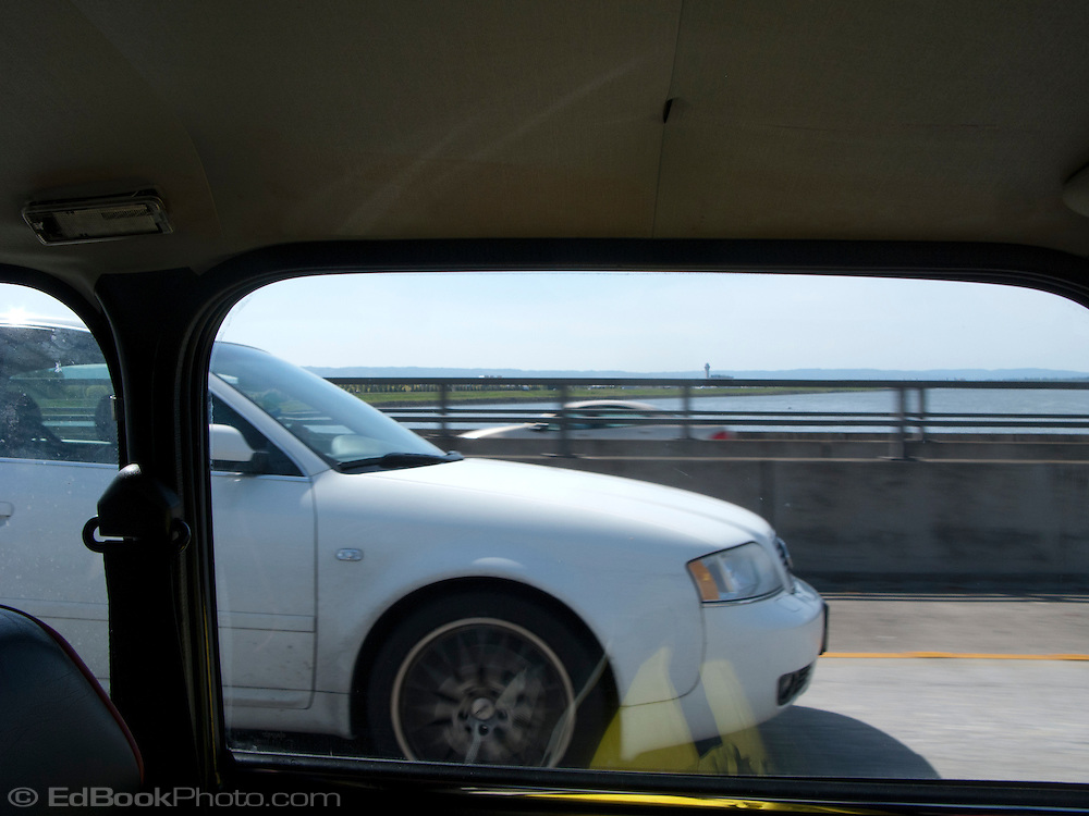 scene along a cross country trip with in a classic Mini Cooper auto - view of the Columbia River obscured by highway barrier on the bridge across the river