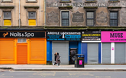 Glasgow, Scotland, UK. 6 Mar 2021. With Scotland remaining under national lockdown during the covid-19 pandemic Glasgow city centre remains a virtual ghost town with few people in the city centre and almost all shops and businesses still closed.  Pic; Closed and shuttered shops near St Enoch Square. Iain Masterton/Alamy Live News