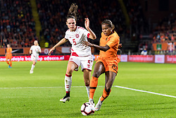 (L-R) Simone Boye Sorensen of Denmark women, Lineth Beerensteyn of The Netherlands women during the FIFA Women's World Cup 2019 play off first leg qualifying match between The Netherlands and Denmark at the Rat Verlegh stadium on October 05, 2018 in Breda, The Netherlands