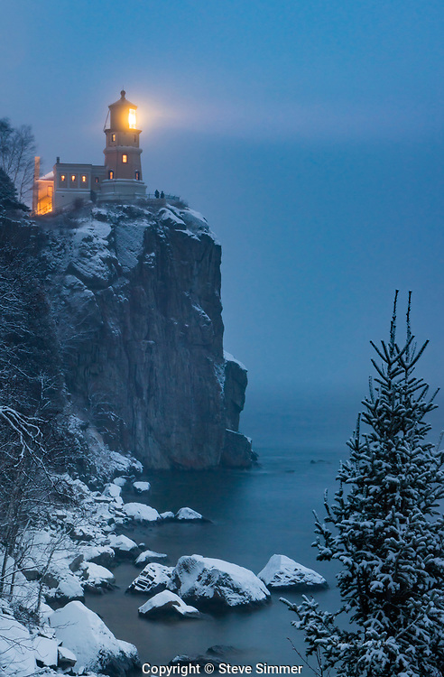 I was positioned on the tramway staircase, waiting for the beacon to be lit as part of the memorial for the crew of the Edmund Fitzgerald. The sun had set, but a blue twilight – influenced by the snow and heavy clouds – hung on.