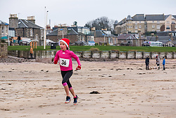 Pictured: Santa Beach Run on the scenic East Lothian coast. This new event is aimed at athletes, casual runners and families. It is hosted by Project Trust with proceeds enabling local school leavers to spend a year volunteering in India/Honduras to teach at a school with few teaching materials.  The fastest young girl in the children's 2km race. 15 December 2018  <br /> <br /> Sally Anderson | EdinburghElitemedia.co.uk