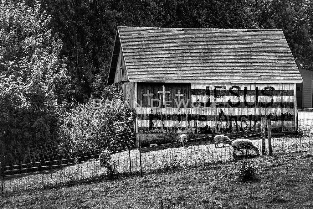An old barn in need of repairs spreads the Word.