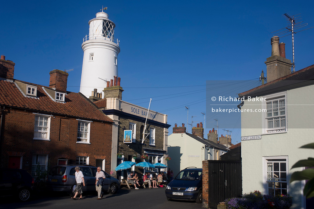 The Sole Bay Inn beneath the famous lighthouse landmark at the Suffolk seaside town of Southwold, Suffolk.