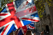Pro-Brexit leave protesters waving Union Jack flags outside The Supreme Court as the second day of the hearing to rule on the legality of suspending or proroguing Parliament begins on September 18th 2019 in London, United Kingdom. The ruling will be made by 11 judges in the coming days to determine if the action of Prime Minister Boris Johnson to suspend parliament and his advice to do so given to the Queen was unlawful.